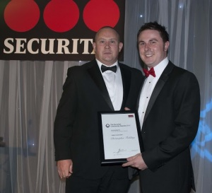 Christopher Fielding (right) accepts his Highly Commended accolade from Clint Reid