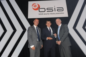 Skills for Security's Mike Britnell (centre) receives the Contribution to Training Award