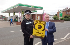 Left to Right: PC Richard Samson (Rutherglen community safety officer) and Jim Anderson (BOSS co-ordinator for Scotland) at the main petrol station in Burnside