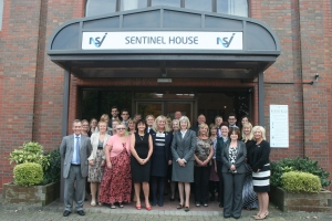 Theresa May outside Sentinel House with the NSI's members of staff