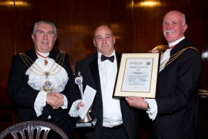 Tom Temple (centre) receives the Sheriffs' Award for 2013