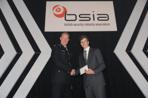 Jack Finley is presented with his 2013 Apprentice Installer Award by Commander Steve Rodhouse of the Metropolitan Police Service