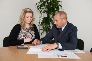 Mike Bluestone, who heads up CorpsConsult, discussing strategies with a client