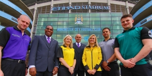 Showsec staff parade the new uniforms outside Manchester City's Etihad Stadium