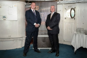 Ken Stewart of The Shield Group (left) with Jeff Davies on board HMS Belfast