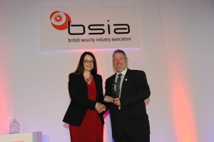 David Bone of Securitas Security Services collects the Contribution to the Community Award