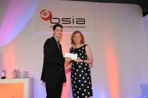 Joe Palmer of VSG receives his award from Baroness Smith of Basildon