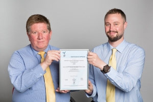 Simon Cooke (UCL's fire safety manager, left) and Keith Todd (UCL's fire safety officer) proudly display the NSI Certificate of Approval