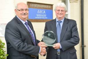 Geoff Tate (right) is presented with the 2014 Peter Greenwood Award by Pat Allen