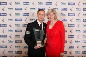 Sergeant Stephen Brown and Home Secretary Theresa May