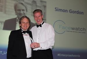 Simon Gordon (left) receives his award