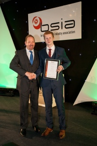 Christopher Hunt (right) pictured with Apprentice Installer Awards compere Alfie Moore