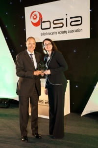 A representative from the Tour of Securitas Team receives the BSIA Chairman's Award from Pauline Norstrom