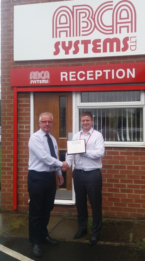 Neil Hughes of TDSi presents the award to ABCA_s Managing Director, Philip Miller
